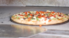Taking Cooked Vege Pizza Out Of Hot Commercial Industrial Stone Oven Restaurant Stock Footage
