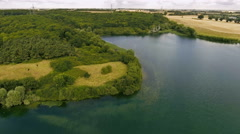 Aerial Shot of Lake Shore, visible trees and grass, natural beauty Stock Footage