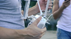Preparing the remote control to fly drone quadrocopter Stock Footage