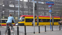 Transportation traffic in city : cars, taxi, bus, tramway, bike - Warsaw, Poland Stock Footage