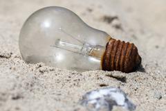 Light bulb in the sand Stock Photos