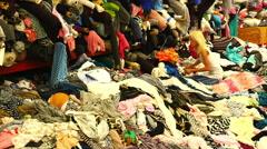 Asian Women Sorting through Fabrics at Los Angeles Fabric Mart Stock Footage