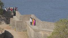 Indian tourists walk around fort,Diu,India Stock Footage