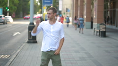 Happy caucasian dancer man funky street dancing freestyle in the city Stock Footage