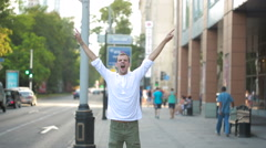 Man jumping for joy in the streets. overjoyed. Stock Footage