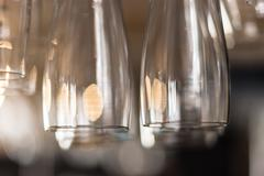 Detail shot of clean wine glasses hanging from a bar rack Kuvituskuvat
