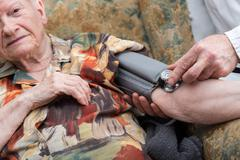 Home medical assistance of seniors Stock Photos