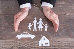 Family, house and car insurance concept Stock Photos