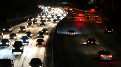 Zoom Out - Fast Traffic on the 101 Freeway in Los Angeles - Night Stock Footage