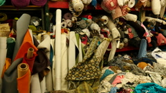 Pan of Colorful Pile of Fabrics - Los Angeles Fabric District Stock Footage