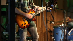 Young electric guitarist player playing guitar, closeup Stock Footage