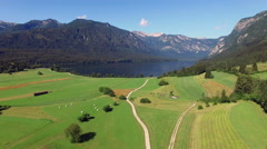 4K. Flight above amazing Bohinj Lake valley in the morning. Stock Footage