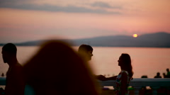 Silhouettes of romantic couple on sunset. Sea background. man and woman kiss Stock Footage