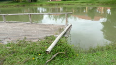 Bamboo pier at the waterside of the pond Stock Footage