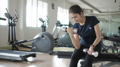 Weights training,  woman in fitness gym lifting weights workout strength body. Stock Footage
