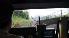 Japanese train arriving in a countryside station POV Stock Footage