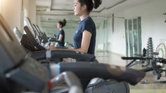 Asian woman walking,  running on treadmill gym workout. Stock Footage
