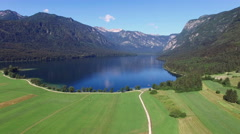 4K. High flight and takeoff above amazing Bohinj Lake in the morning. Stock Footage