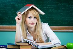 Annoyed, bored, tired, woman, funny looking student Stock Photos