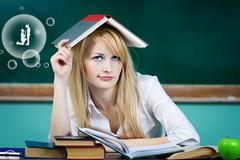 Daydreaming student, female teacher Stock Photos