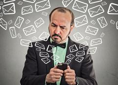 Business man busy sending messages emails from smart phone Stock Photos