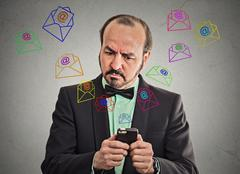 business man busy sending messages emails from smart phone - stock photo