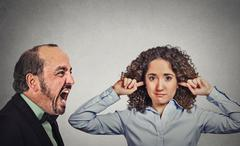 Angry mature man screaming at his young wife woman Stock Photos