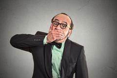 Shut up mouth, keep corporate deals secret Stock Photos