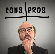 Pros and cons, for and against argument concep Stock Photos