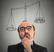 businessman with scale above head - stock photo