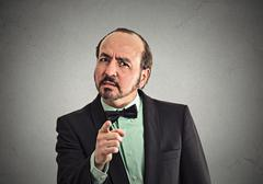 serious middle age man pointing at you with index finger - stock photo