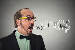 Man talking symbols alphabet letters coming out of mouth Stock Photos
