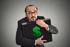 Money greed Stock Photos