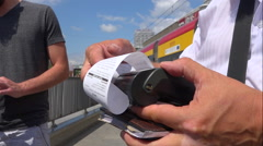 Paying fine ticket POV, tramway station, electronic payement - Warsaw, Poland Stock Footage