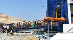Tourists arriving to Santorini's port on board Seats catamaran super ferry Stock Footage
