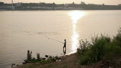 Silhouettes of young Asia man fishing on the lake Stock Footage