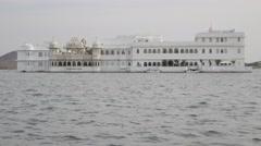 Taj Lake Palace heritage hotel on island in lake Pichola,Udaipur,India Stock Footage