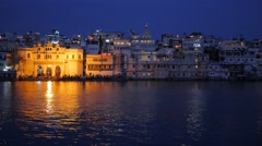Gangaur Ghat at lake in evening lights,Udaipur,India Stock Footage