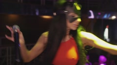 Sexy mc girl in hare mask red bodysuit dance on stage in nightclub. Spotlights - stock footage