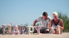 Blurred background of family having rest on beach Stock Footage