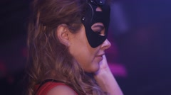 Dj girl in black hare mask, red dress mixing at turntable in nightclub. Dance Stock Footage