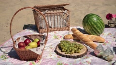 Picnic with different sorts of snacks on blanket Stock Footage