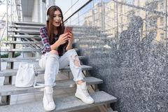 Carefree girl entertaining with smartphone and music Stock Photos