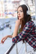 Dreamful girl listening to song from headphones Stock Photos