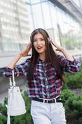 Cute woman enjoying melody and walk Stock Photos