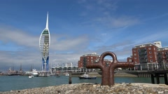 Low angle view, Gunwharf quays and spinnaker tower from Spice Island Portsmouth Stock Footage