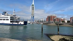 Gunwharf quays Portsmouth with Isle of Wight car ferry passing close by Stock Footage
