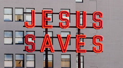 Rooftop Neon Jesus Saves Sign - Los Angeles Stock Footage