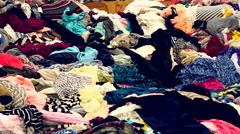 Zoom Out of Colorful Pile of Fabrics - Los Angeles Fabric District Stock Footage