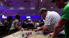 Motion of people playing casino roulette inside Hard Rock Casino. Stock Footage